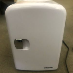 White mini refrigerator